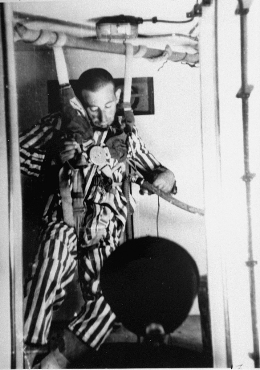 A prisoner in a special chamber loses consciousness in response to changing air pressure during high-altitude experiments.  For the benefit of the Luftwaffe, conditions comparable to those found at 15,000 meters in altitude were created in an effort to determine if German pilots might survive at that height.