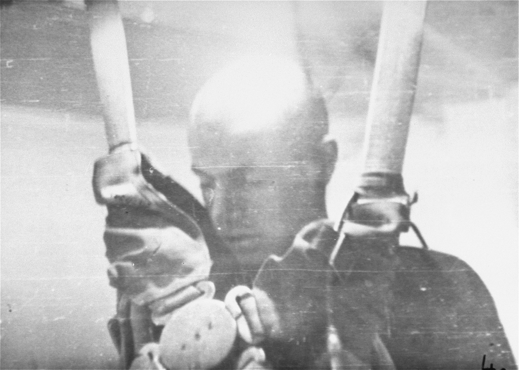 A prisoner in a special chamber falls into unconsciousness after being subjected to low pressure experimentation.  For the benefit of the Luftwaffe, air pressures were created comparable to those found at 15,000 meters in altitute, in an effort to determine how high German pilots could fly and survive.
