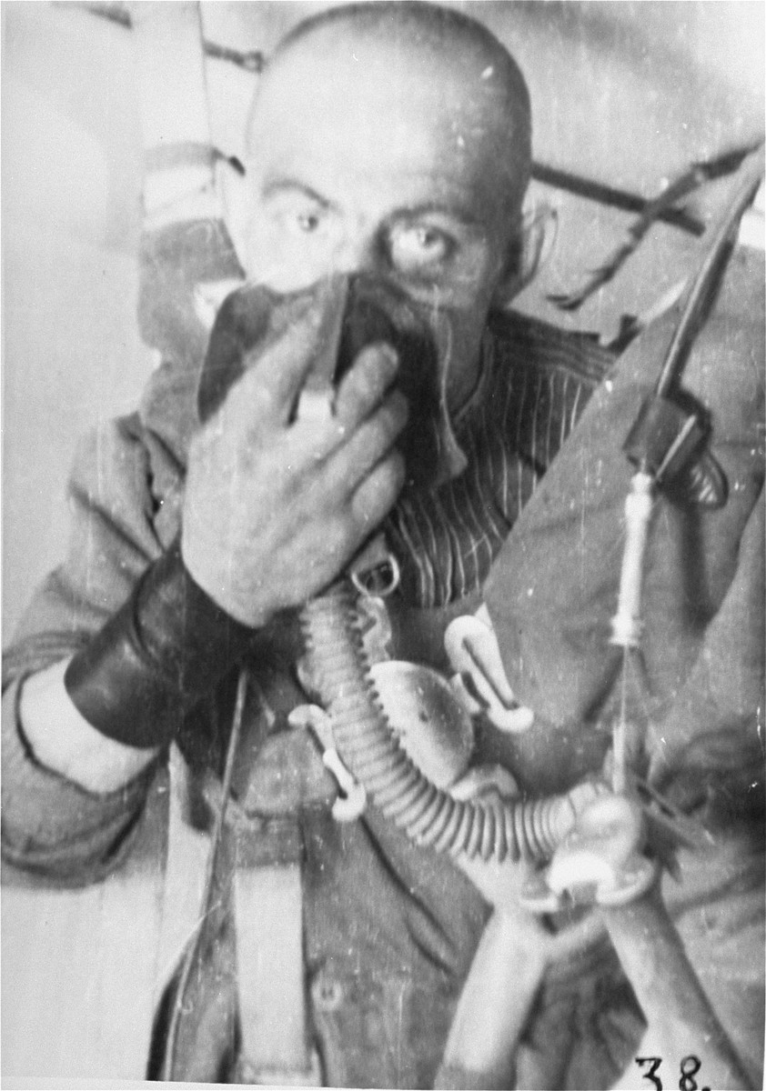 A prisoner who is being subjected to low pressure experimentation.  For the benefit of the Luftwaffe, air pressures were created comparable to those found at 15,000 meters in altitude, in an effort to determine how high German pilots could fly and survive.
