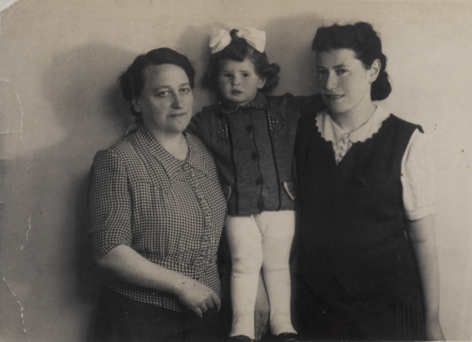 Portrait of two women and a young child in the Tarnow ghetto.  Among those pictured (center) is Elizabeth Lusthaus.  Her great aunt is pictured on the left and her mother Helena Lusthaus is on the right.  The aunt perished in the Holocaust.