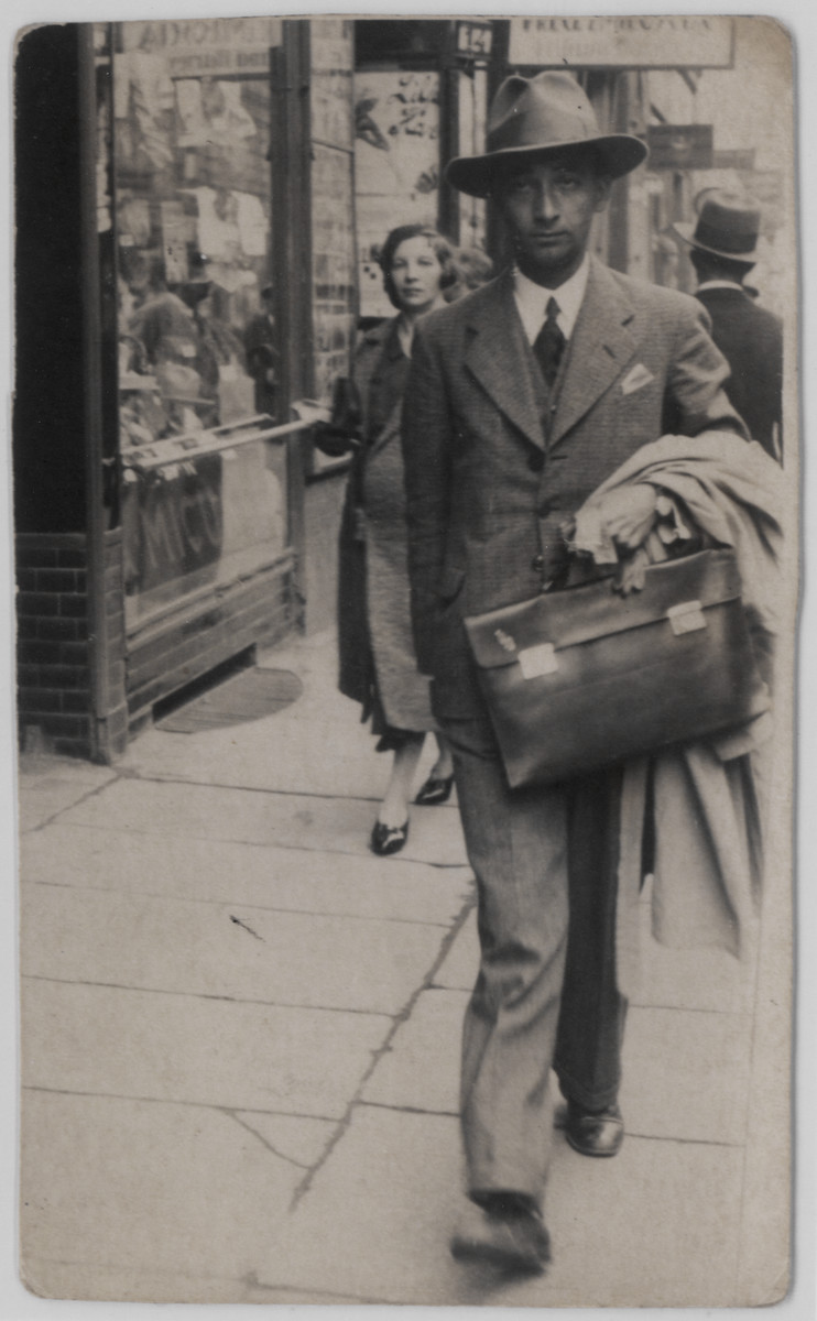 Benedykt Lusthaus (uncle of the donor), a botony  professor at the University of Lodz, walks down a street carrying a briefcase.  He survived the war hidden by his Christian fiance Hanka Halicz whom he later married.
