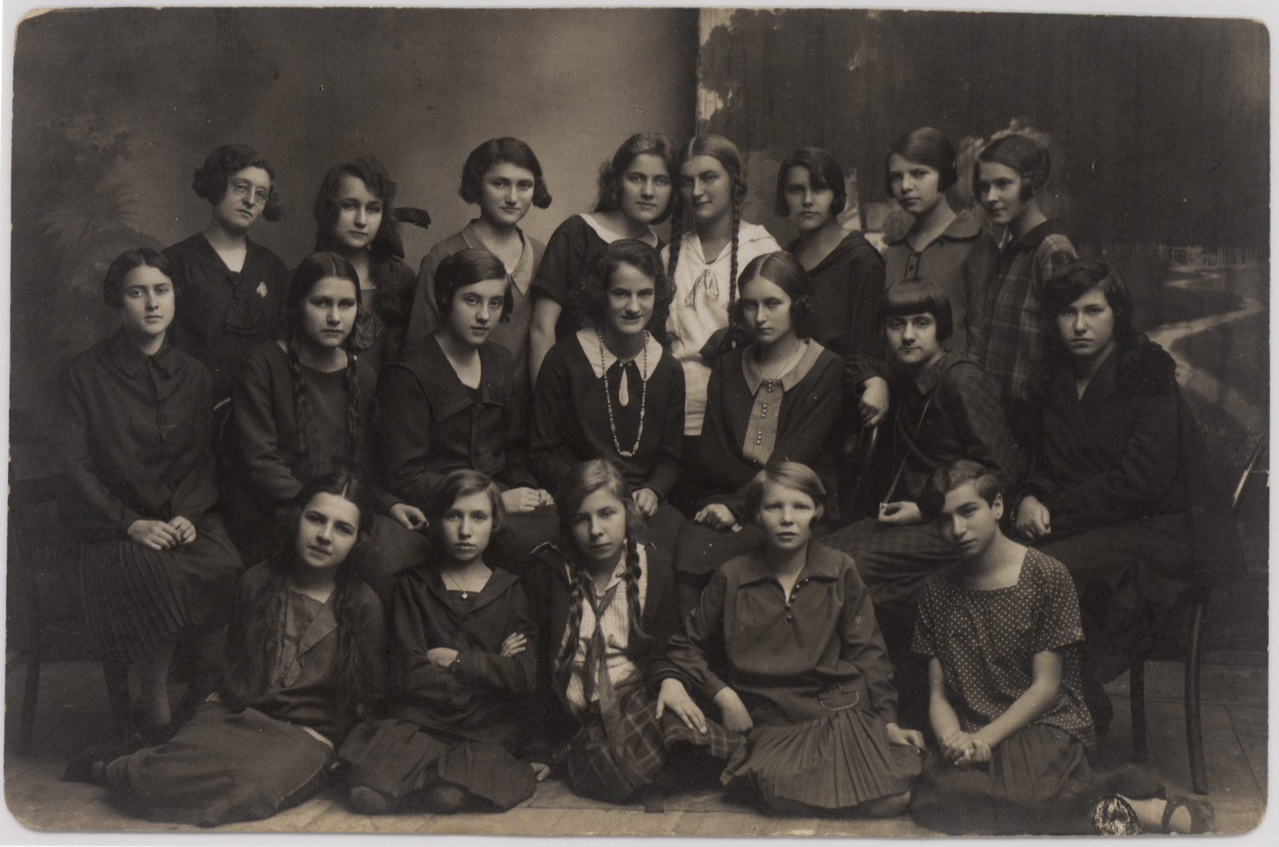 Portrait of a group of young women in a gymnasium class in or near Sanok.  Helena Amkraut is pictured in the middle row on the right.