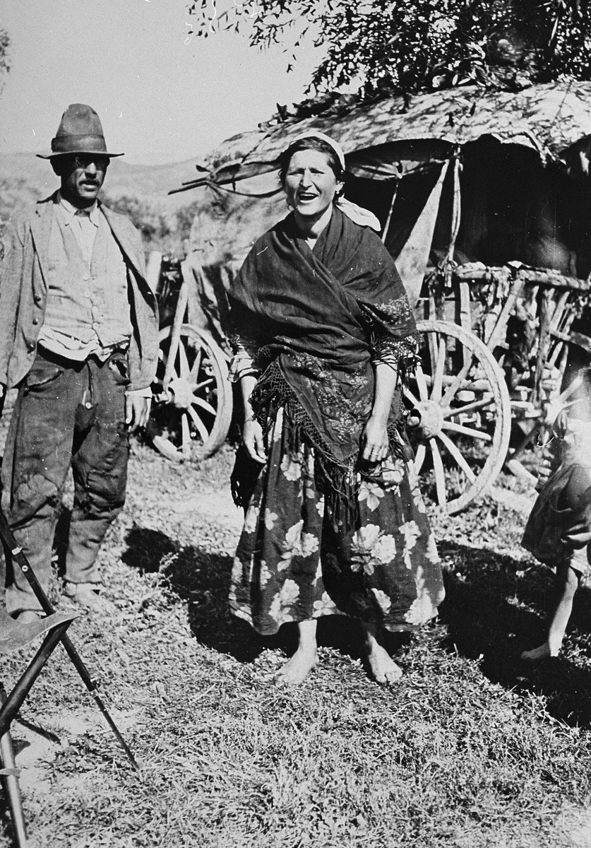 A Gypsy family poses in front of their wagon.