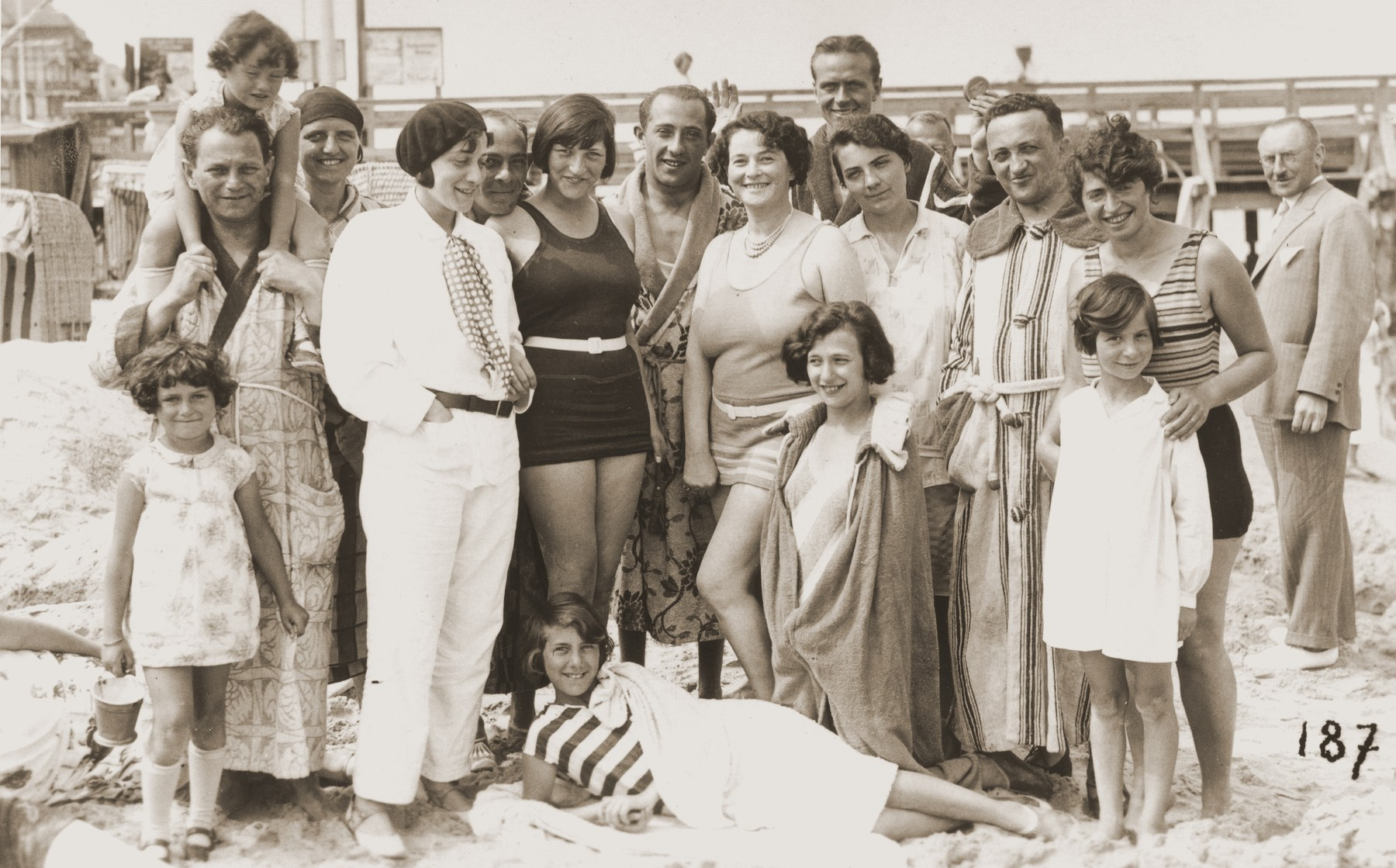 Inge Marx and Trude Zenner (extreme right) pose with their families on a beach on the Arendsee.
