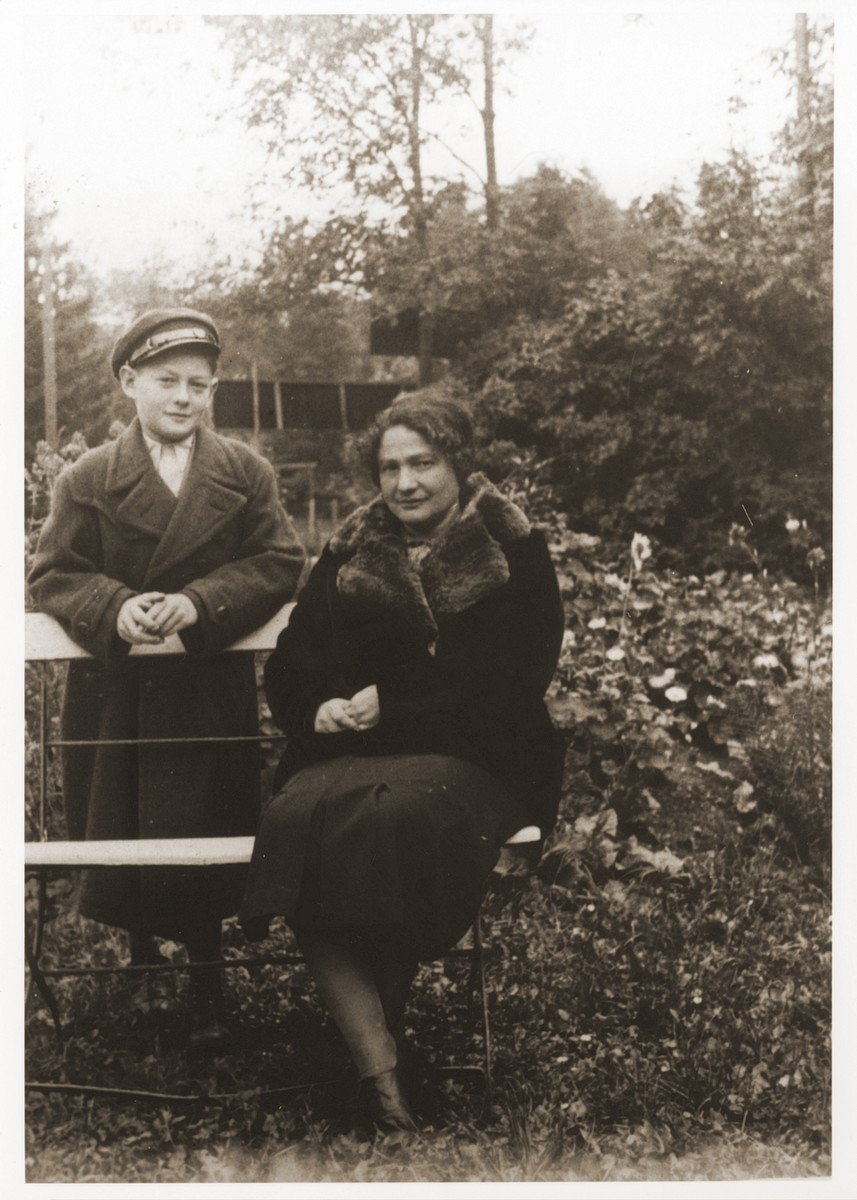 A Jewish mother and son pose outside in a park in Drohobycz, Poland.  Pictured are Pearl Littman and her son Oskar.