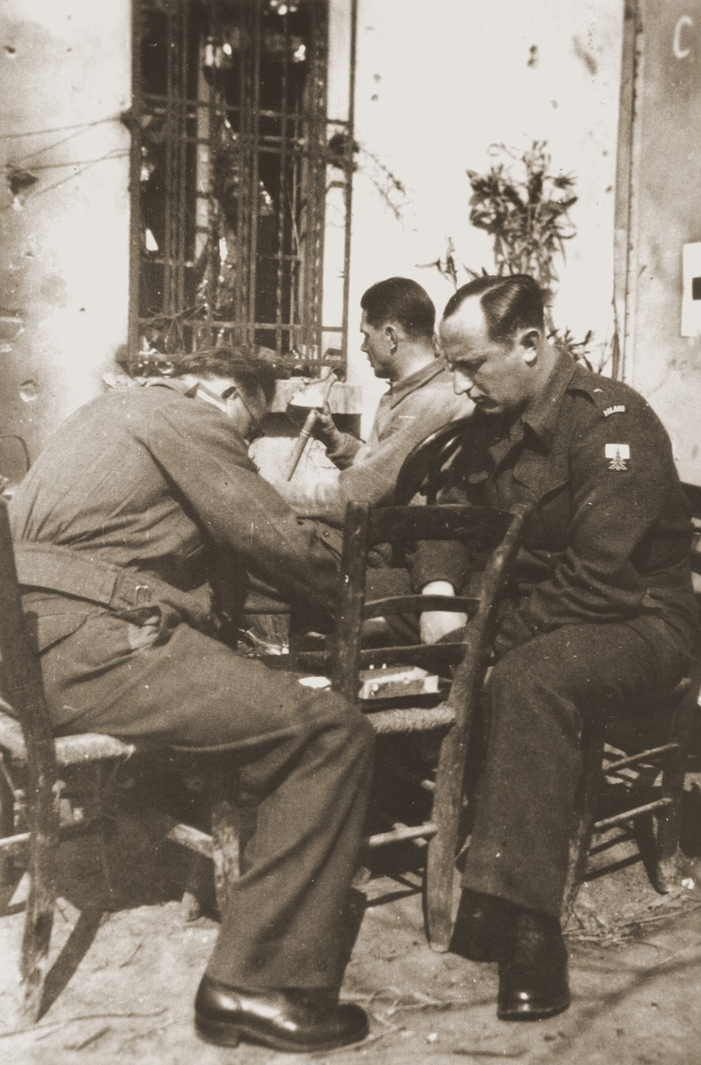Two members of the Anders Army play chess.  Dr. Arthur Haber, originally from Krakow, survived the war as a doctor in the Anders Army.  His wife, Sophie Ament Haber, escaped the Bochnia ghetto with her family in June 1943.  After liberation she found her husband in Italy.