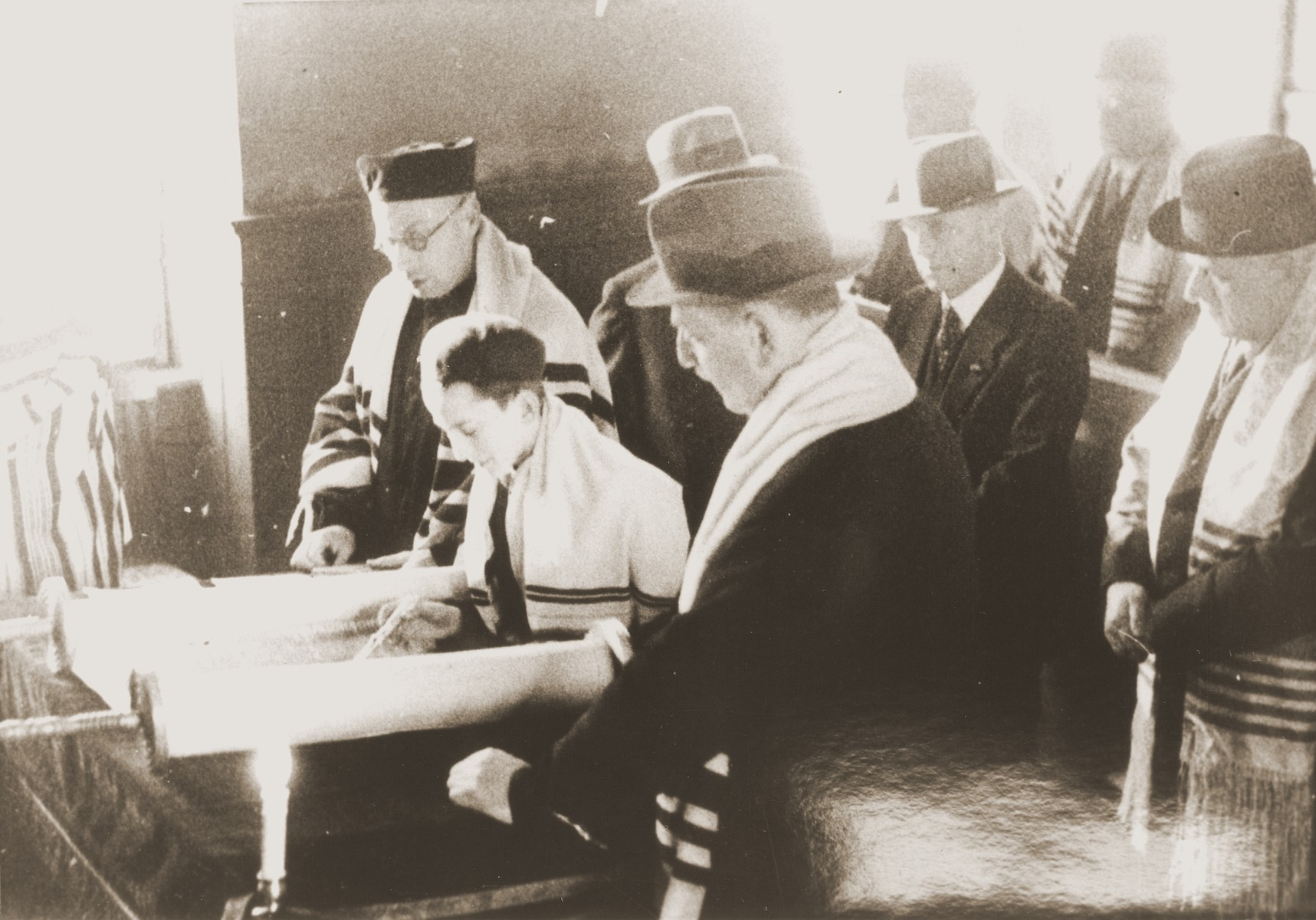 Ludwig Nachmann (center foreground), the president of the congregation, follows the Torah reading during a bar mitzvah at the liberal Zerrennerstrasse synagogue in Pforzheim.