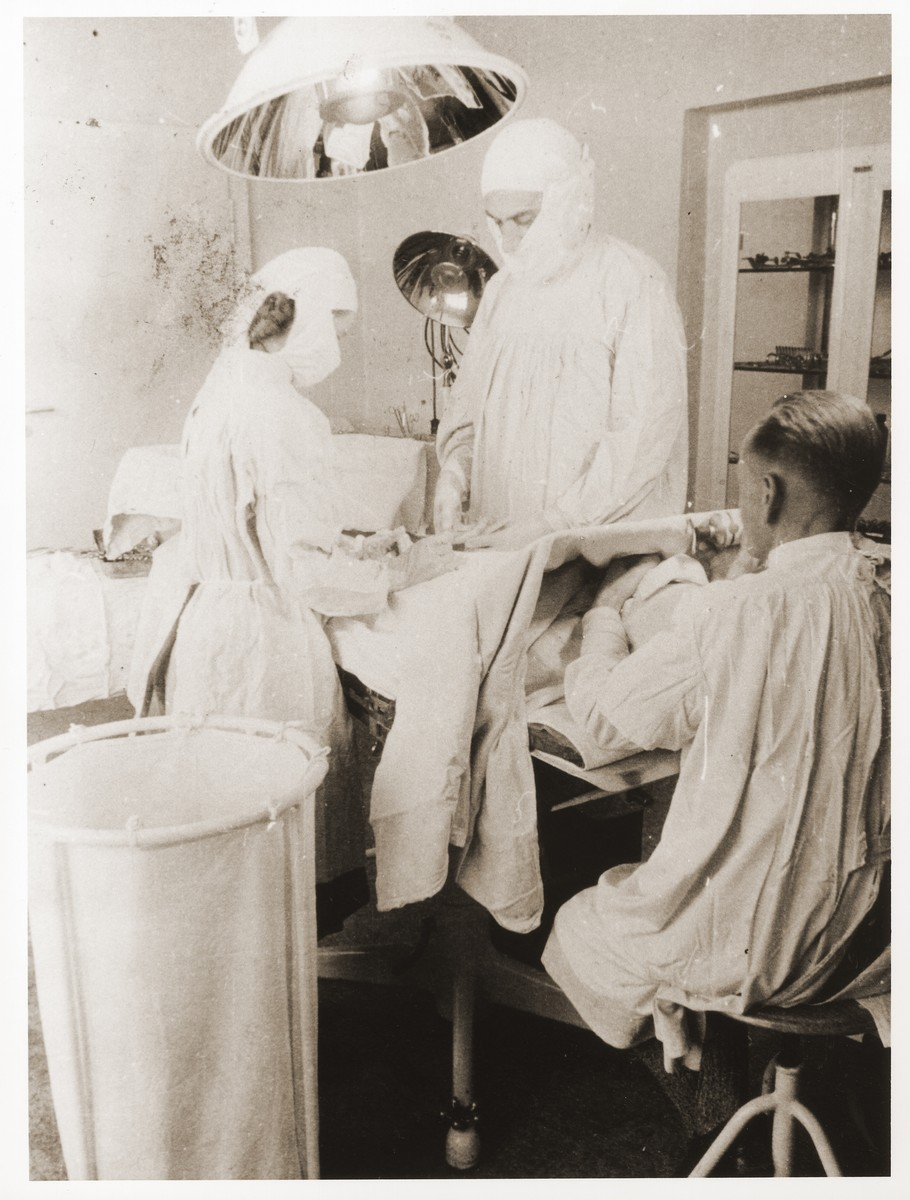 Dr. Hasler performs surgery in the Foehrenwald displaced persons camp.