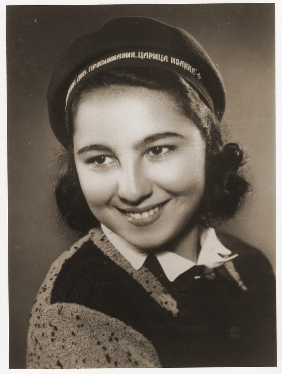 Portrait of Stella Nahmias, wearing her school cap.