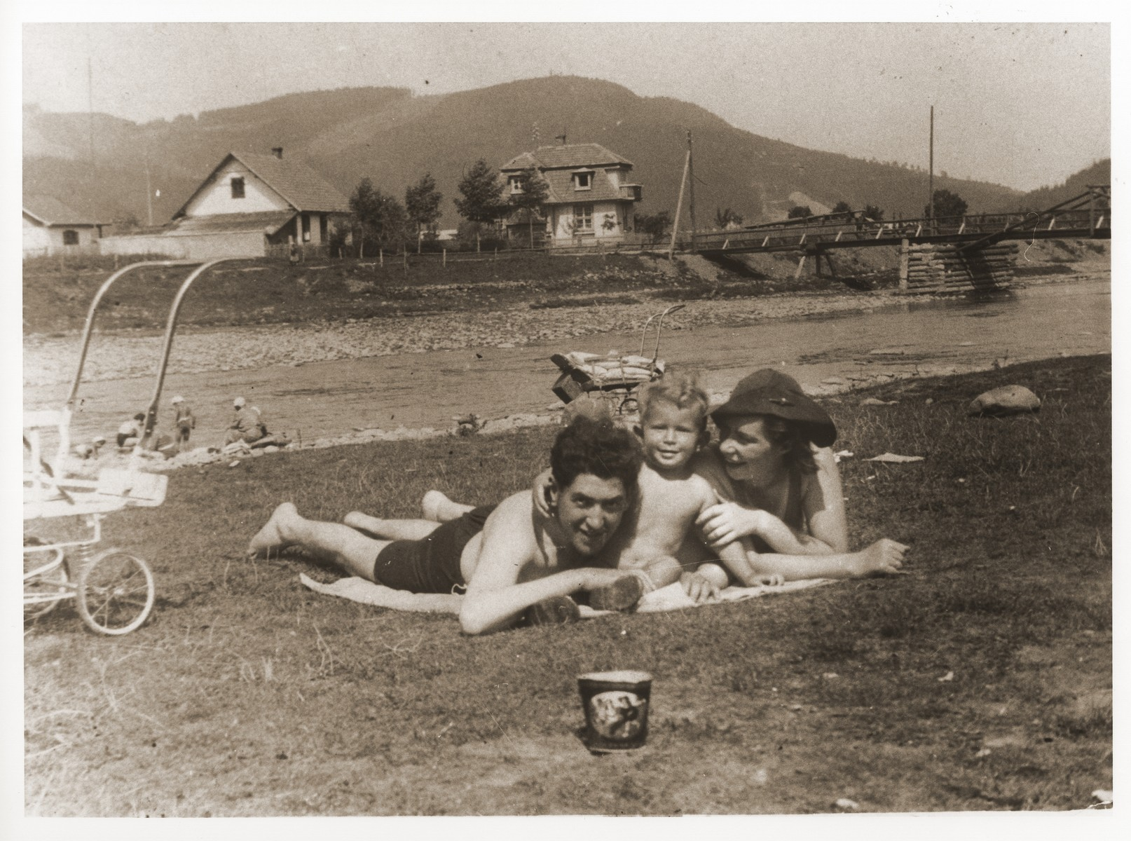 A Jewish couple sunbathes with their son on the beach in the resort town of Skole, shortly before the German invasion of Poland.  Pictured are Izio and Anda Littman with their son, Otto.