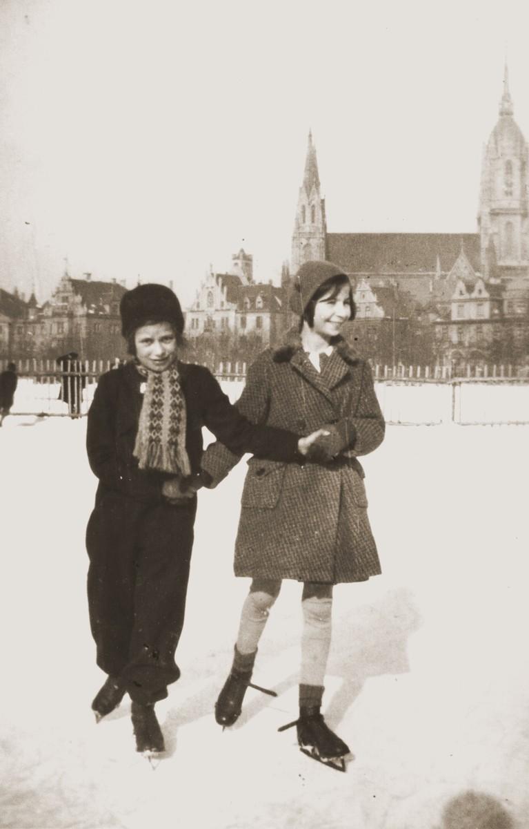 Inge Marx ice skates with her friend, Hannah Lichtenauer.