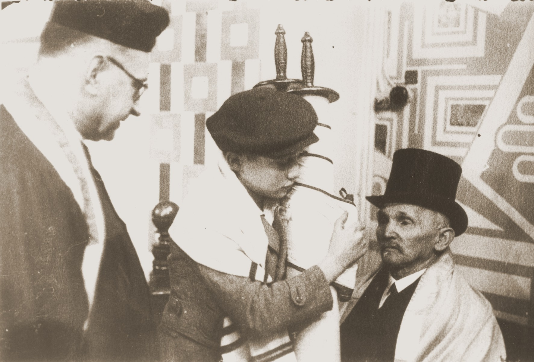 Siegbert Levy hands the Torah scroll to his great uncle (right) during his bar mitzvah at the liberal Zerrennerstrasse synagogue in Pforzheim.