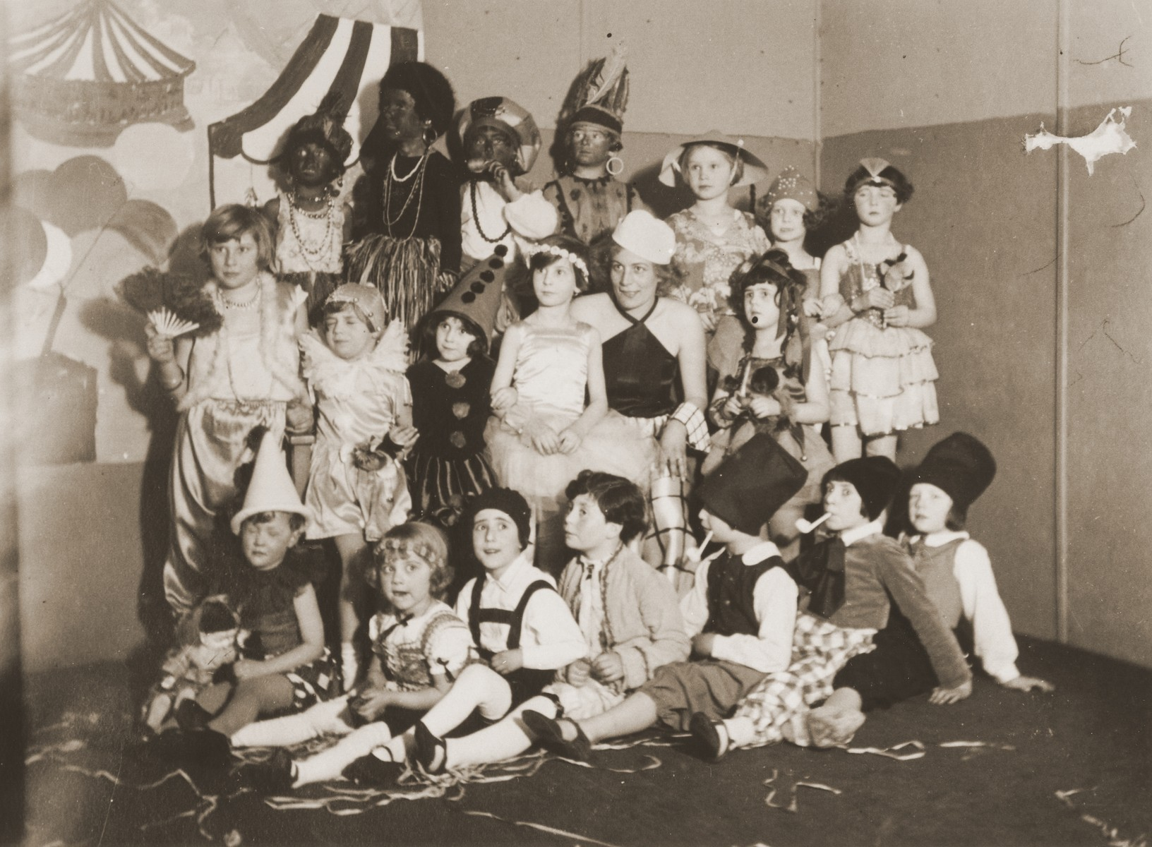 Children in Inge Marx's dance class pose in their costumes.