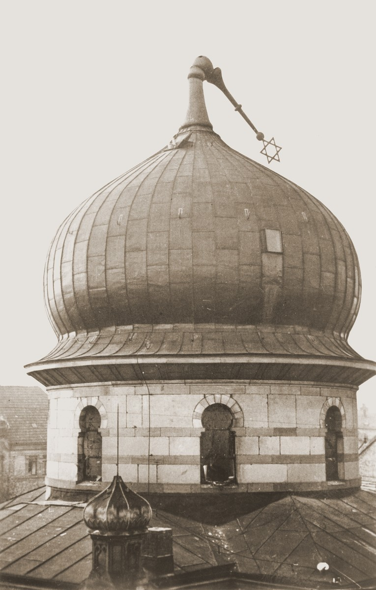 The Star of David atop the Zerrennerstrasse synagogue in Pforzheim lies bent over the cupola as a result of the burning of the synagogue on Kristallnacht.  The cornerstone for the Zerrennerstrasse synagogue in Pforzheim was laid on June 3, 1891, and the finished building was dedicated on July 27, 1892.