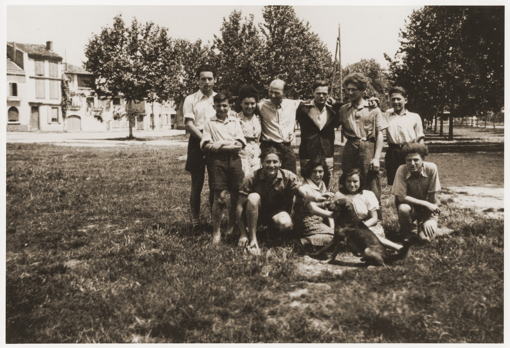 Group portrait of Jewish youth at the Hotel du Moulin in Moissac.    The Hotel du Moulin residence for displaced Jewish youth was operated by the French-Jewish scouting movement, Eclaireurs Israelites de France.  Among those pictured is Walter Karliner (back row, third from the right).