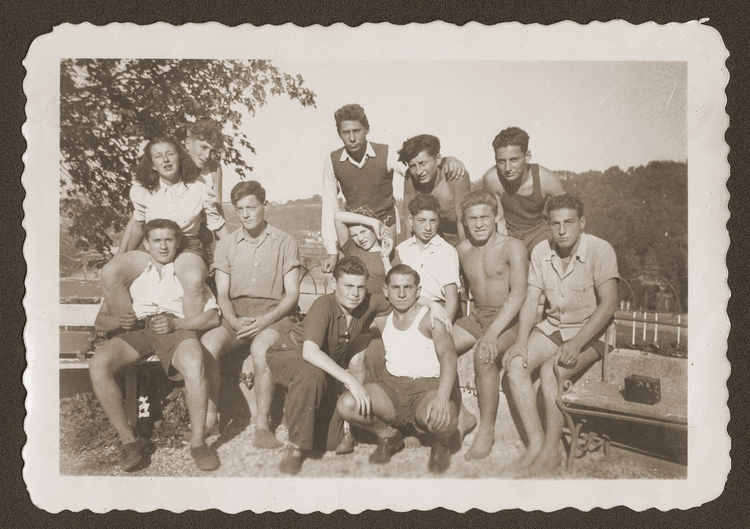 Group portrait of Jewish youth living at the OSE (Oeuvre de Secours aux Enfants) children's home at Collognes au Mont d'or.    Among those pictured are Siegfried Weissmann (first row in the white tank top) and Kurt Leuchter (standing on the far right).
