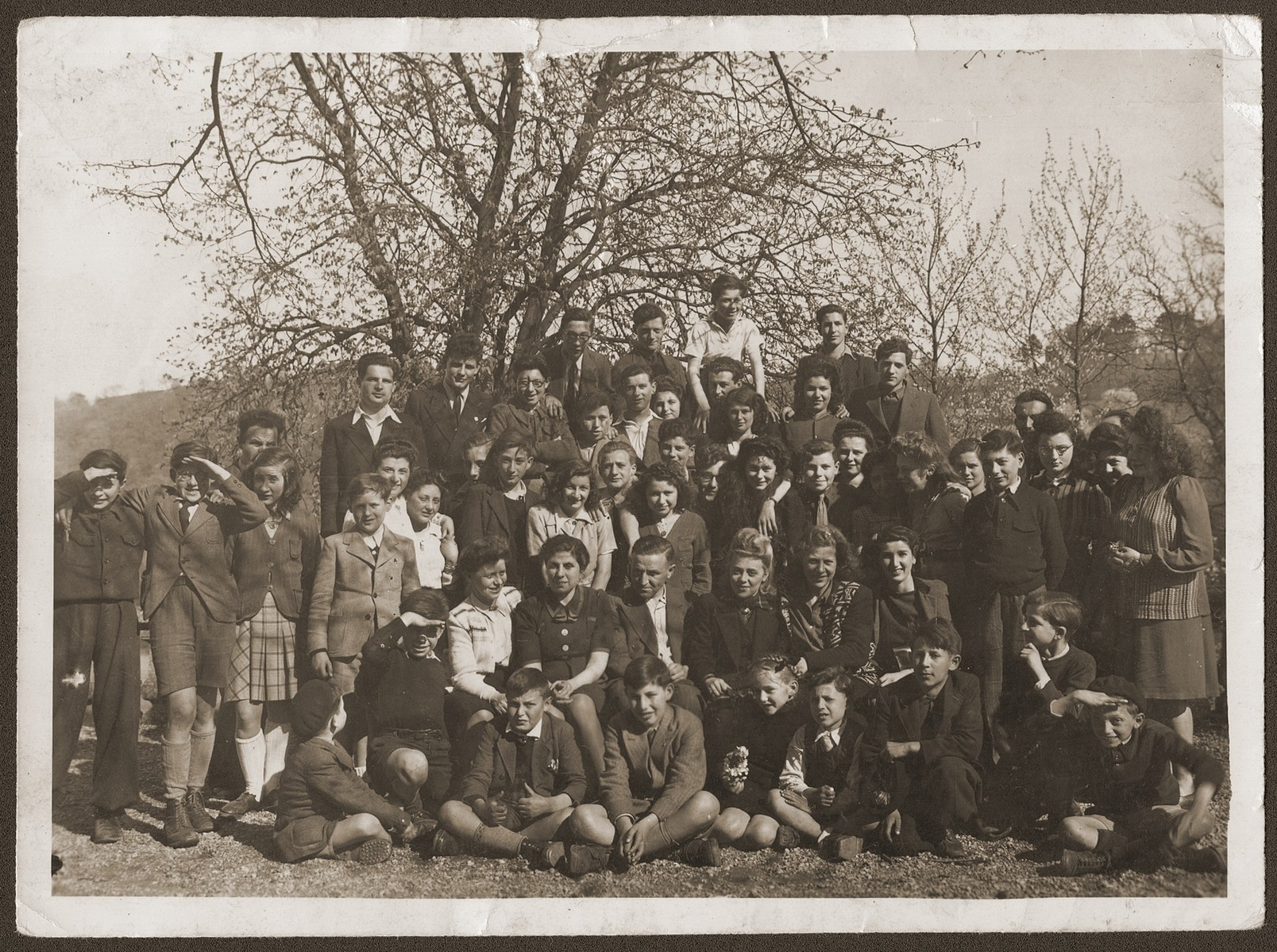 Group portrait of Jewish youth and staff from the OSE children's homes at Collognes and Le Tremplin.    Among those pictured are the directors of the Collonges home, Mr. and Mrs. Hannau (second row, center) and Yvonne Rocque, director of Le Tremplin (second from the right).