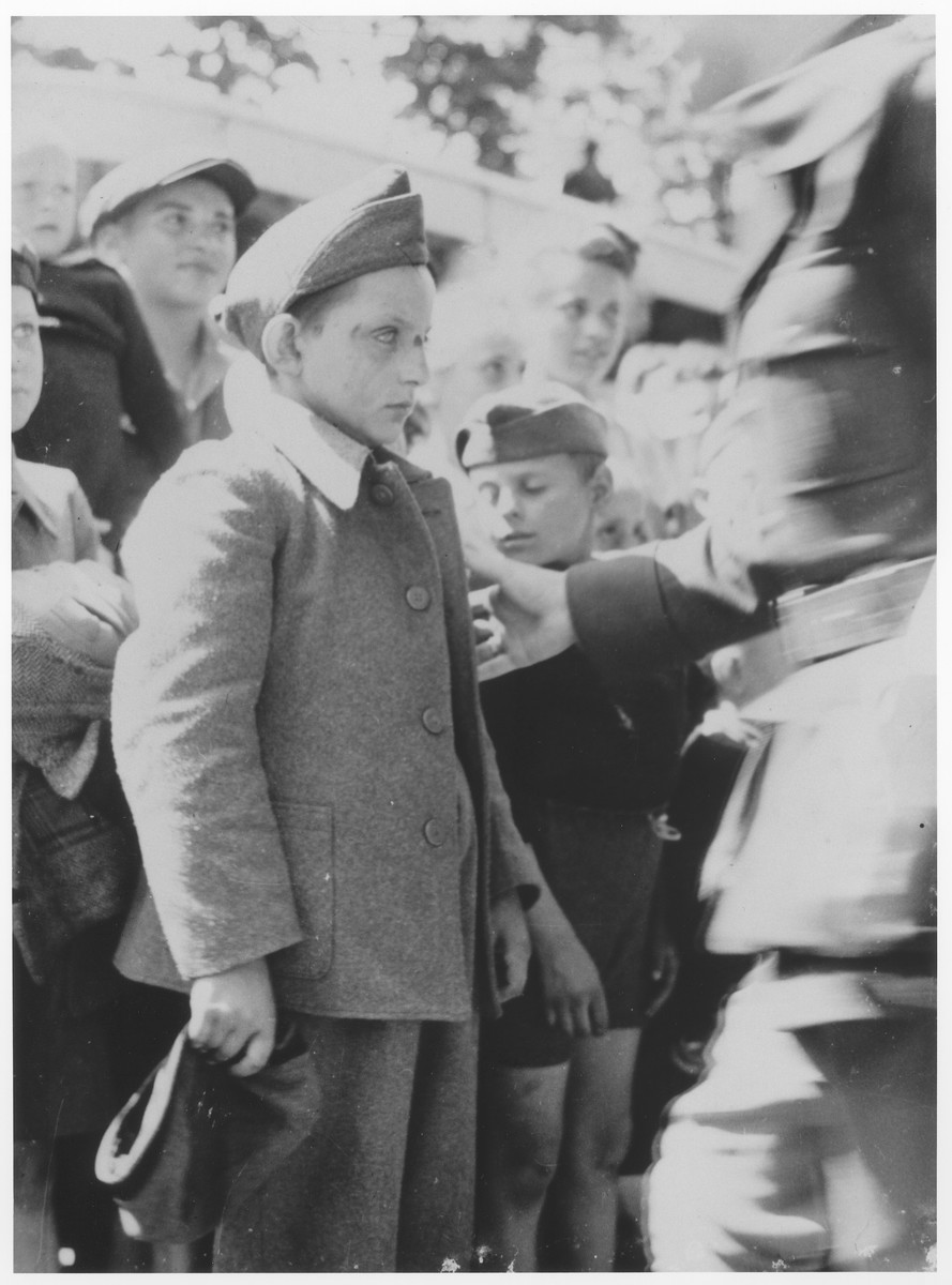 A member of the Buchenwald children's transport is greeted upon his arrival in the Ecouis children's home.