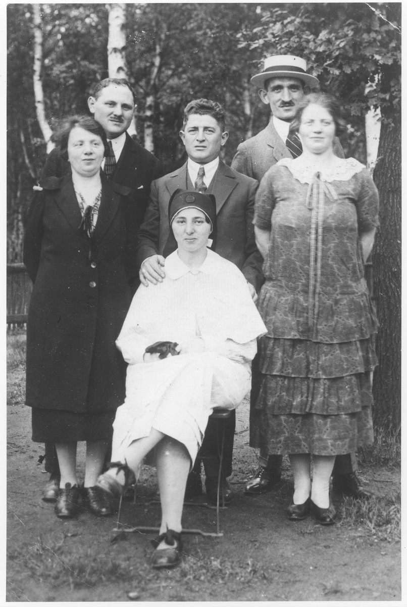 Members of the Stiefel and Zwienicki families in a city park in Hamburg.  Standing are Jenny Stiefel Josias, Mendel Josias, Joseph Zwienicki, Adolf Wolff, Martha Stiefel Wolff, and sitting is Erna Josias, a nurse in the Hamburg Jewish Hospital.