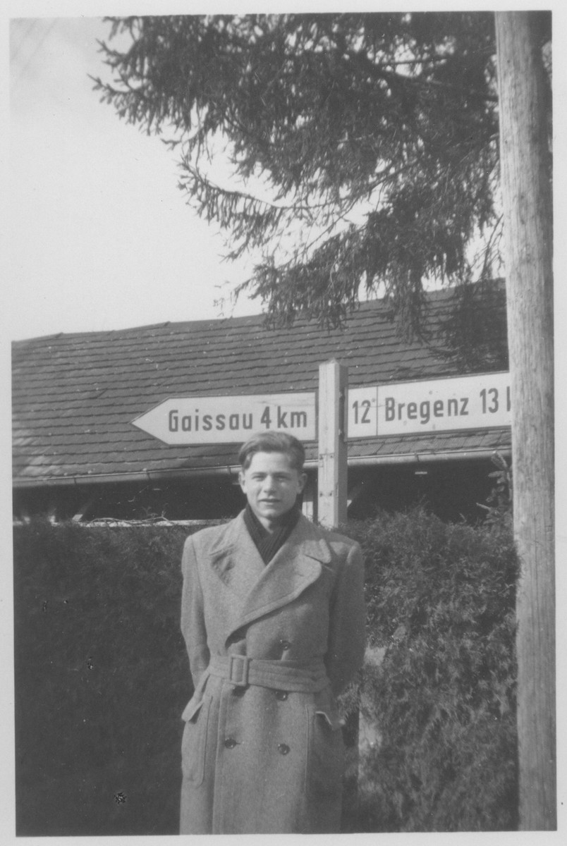 Norbert Bikales stands by a marker on the Swiss-Austrian border where he met his brother for the first time after liberation.