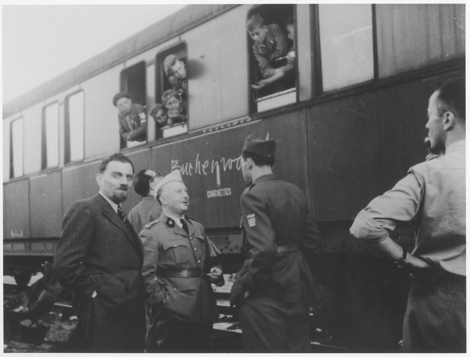 OSE official, Joseph Weill (left), and Dr. G. Revel (center) greet the Buchenwald children's transport upon its arrival in the Les Andelys train station.  From here the children will be taken to the Ecouis children's home.