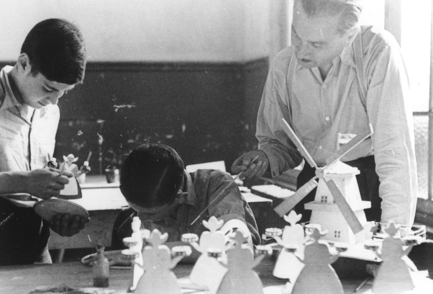 Two Jewish boys make figurines in a woodworking class in the Ecouis children's home.  Pictured at the left is Hans Oster, and in the center is Ivar Segalowitz.