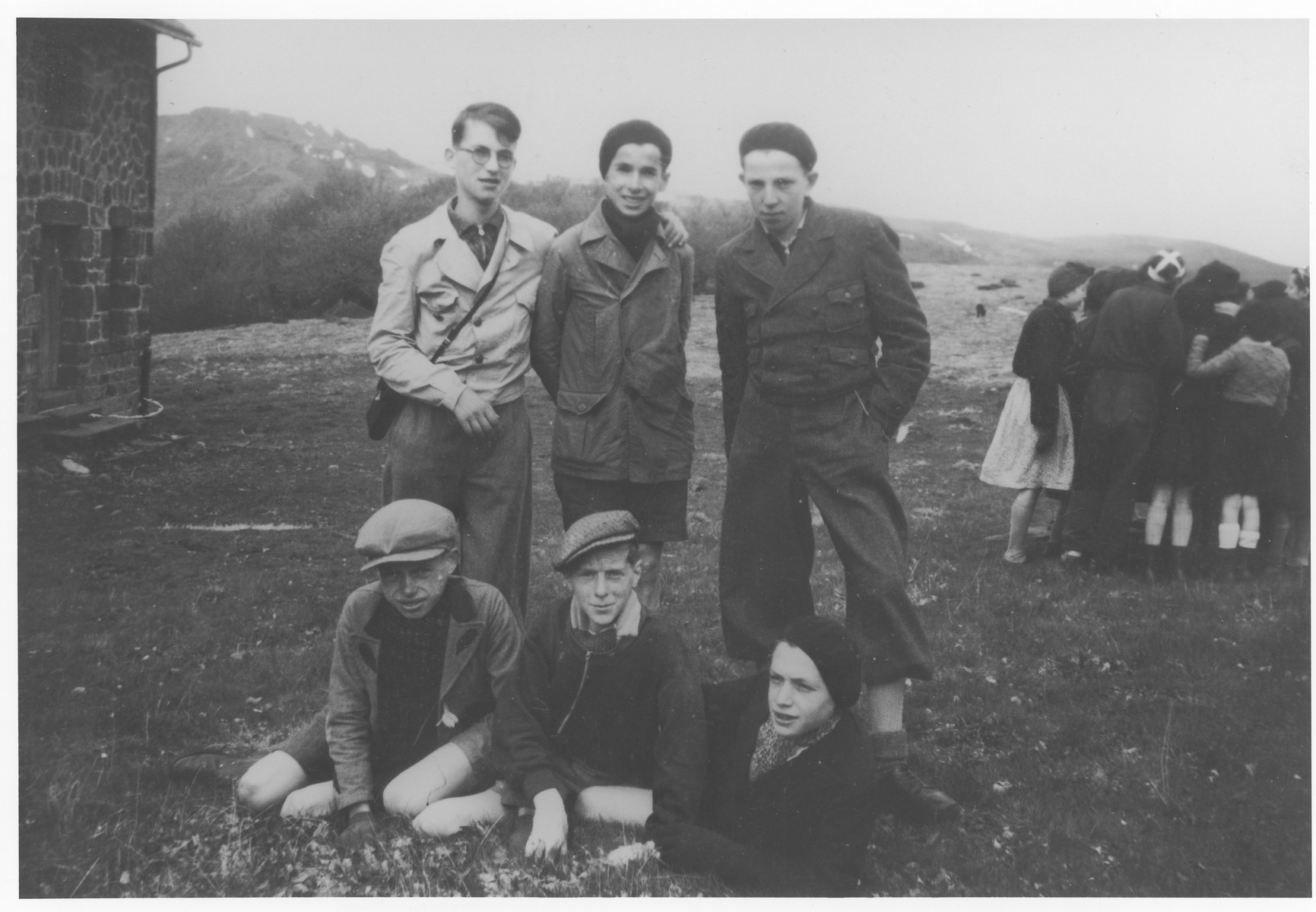 Werner Neuberger poses outside with a group of friends from the La Guette children's home.   Front row (left to right) Hans Blum, Edi Weiss, and Werner Neuberger.  Standing: Karl Schwarz, Herbert Ruhm amd Ludwig (Lutz) Scheucher.