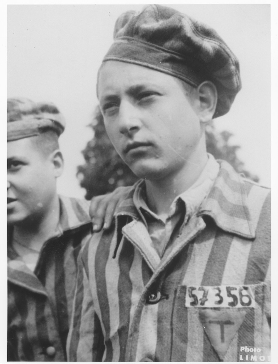Portrait of a member of the Buchenwald children's transport wearing his camp uniform.  The uniform of the boy probably originally belonged to Mozes Kunitz (b. 12/7/26) in Sighet.