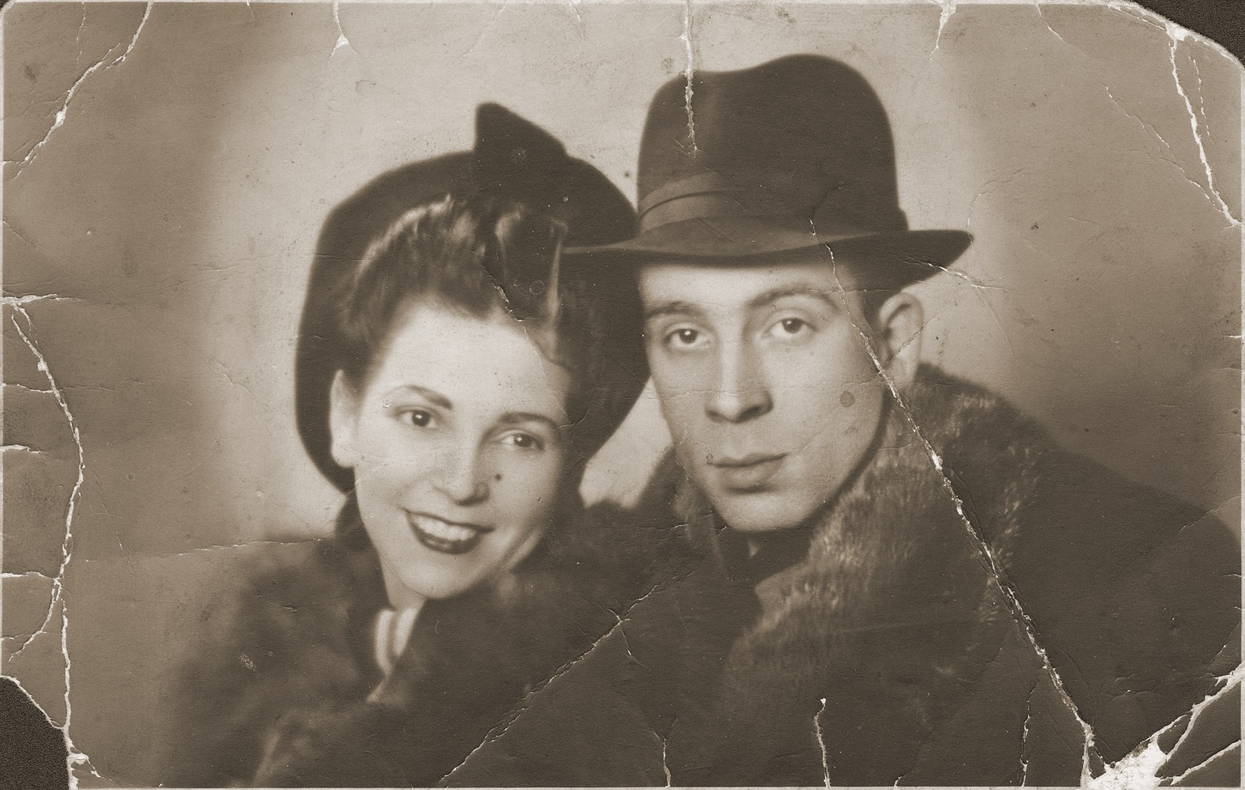 Portrait of Jakub and Zofia Zajd Berkowitz six months after their wedding.    This photograph was found in the gutter in 1943 by a friend who was a member of the Sonderkommando assigned to clean up the ghetto after its liquidation.