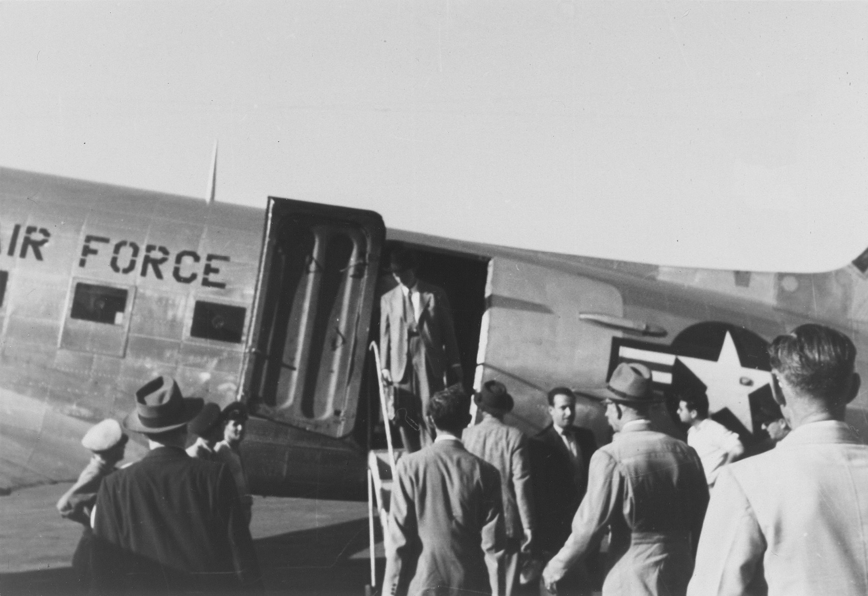 James Grover McDonald stands in the doorway of a U.S. Air Force plane that is taking him to a conference on refugees in Istanbul, Turkey.