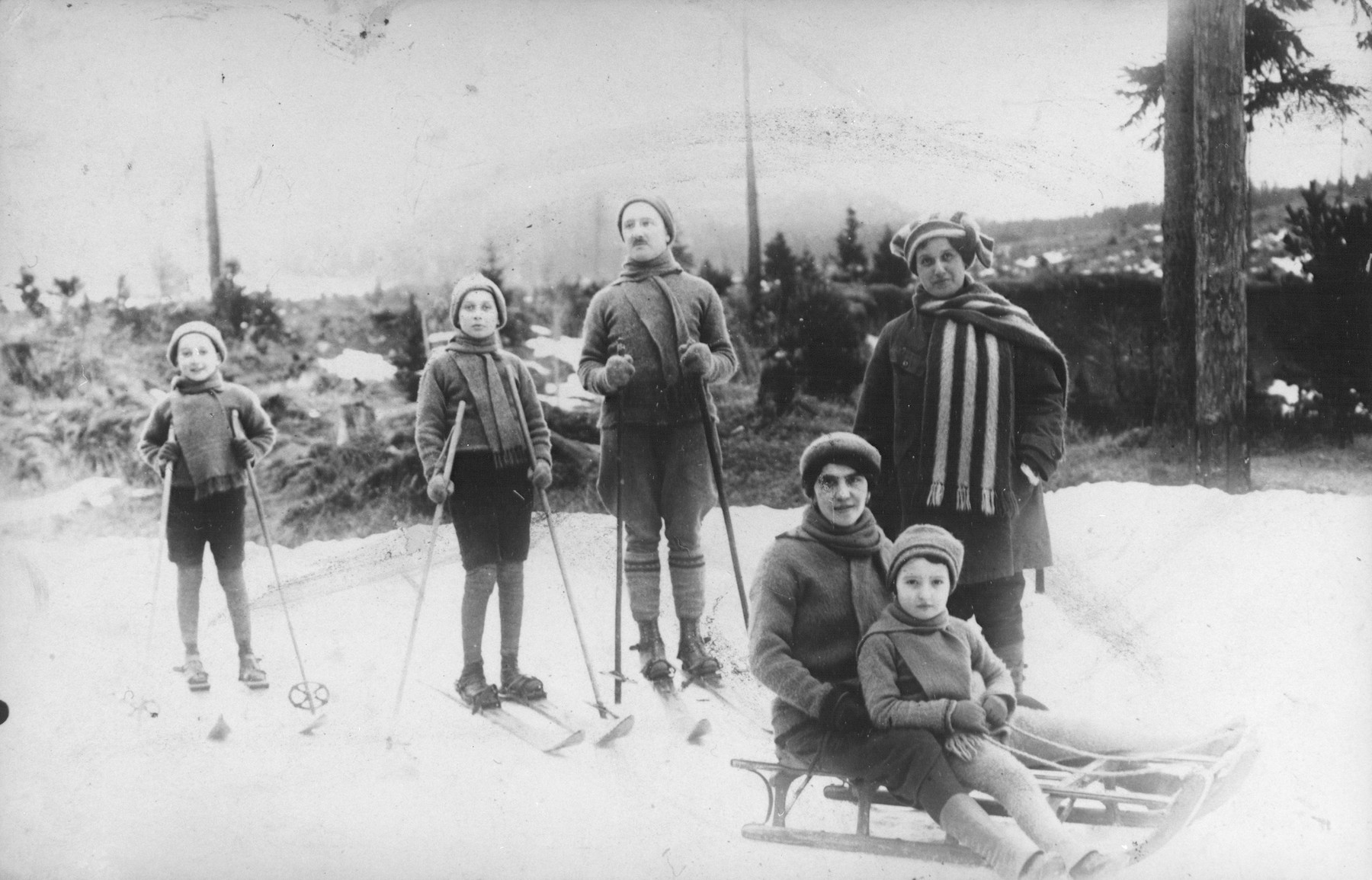 The Kohn family on a skiing vacation.  Pictured standing from left to right are: Erich, Walter, Viktor and Emilia.  Seated are Fraulein Zempanek (Ruth's caretaker) and Ruth.