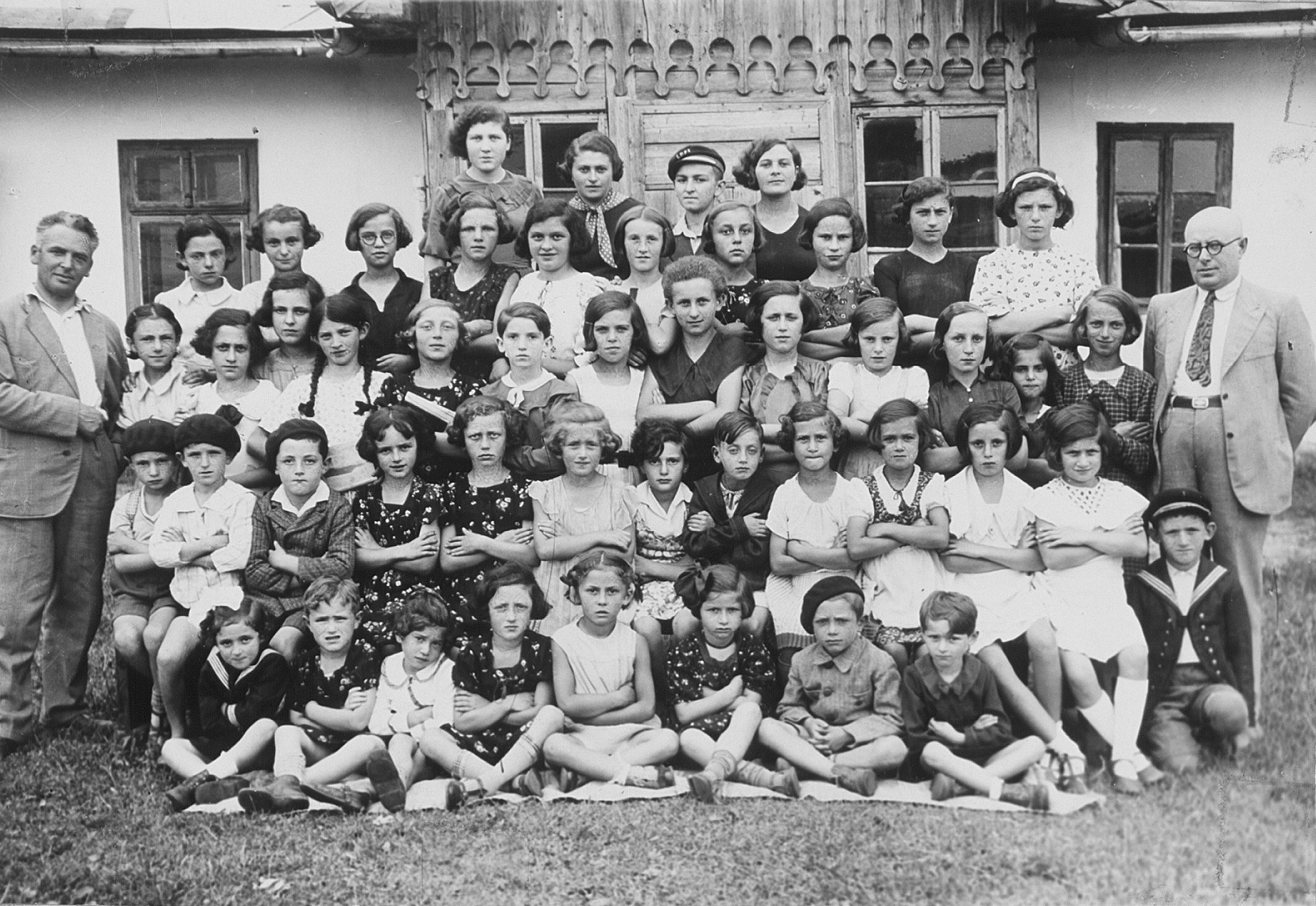 Group portrait of teachers and students of the Hebrew language school in Sanisesti, Romania.  The photo was taken on the occasion of the fifth anniversary of the school in 1936.  Among those pictured is Ephraim Neuman (the man standing on the far right).