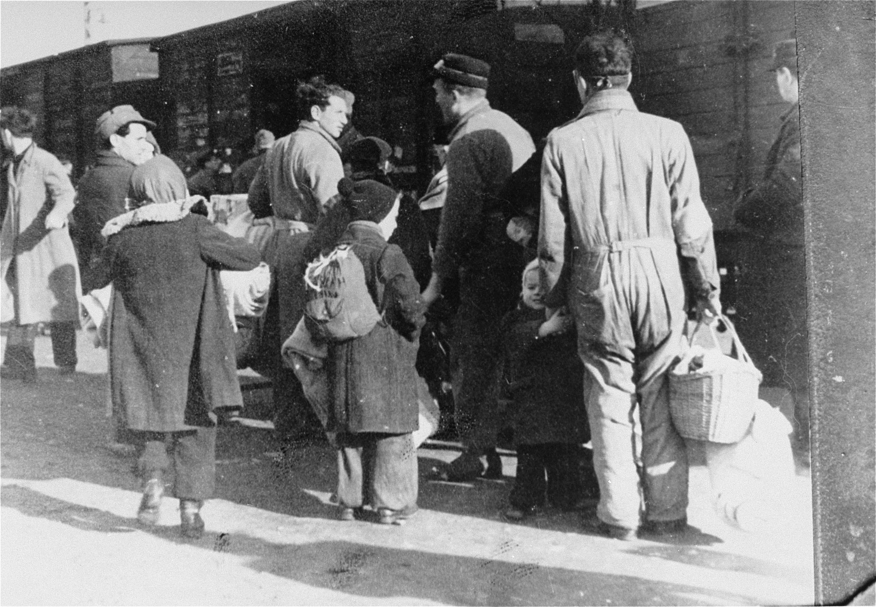 Members of the Ordedienst (Jewish police) supervise the deportation of Jews from the Westerbork transit camp.