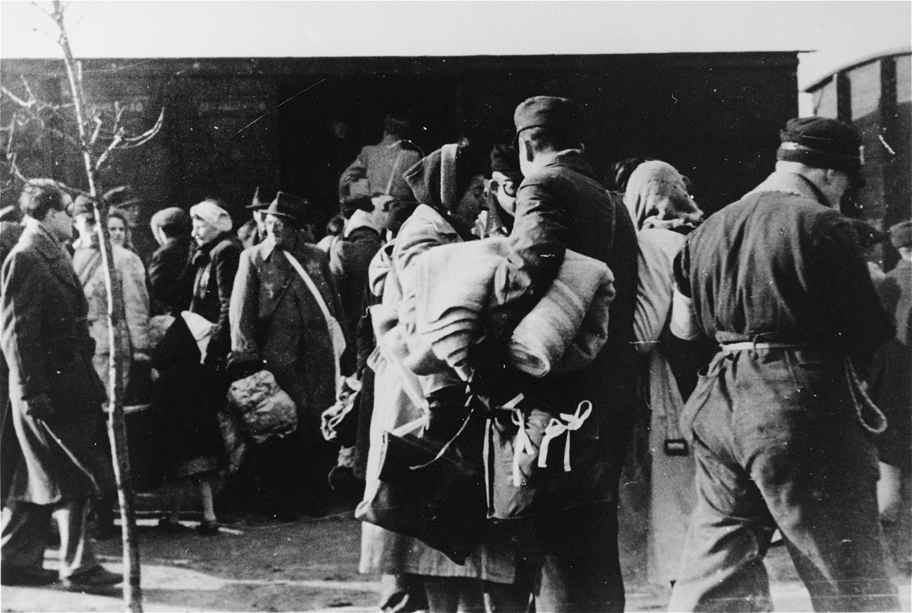 The deportation of Jews from Westerbork.  Members of the Ordedienst (Jewish police) are visible in the foreground.