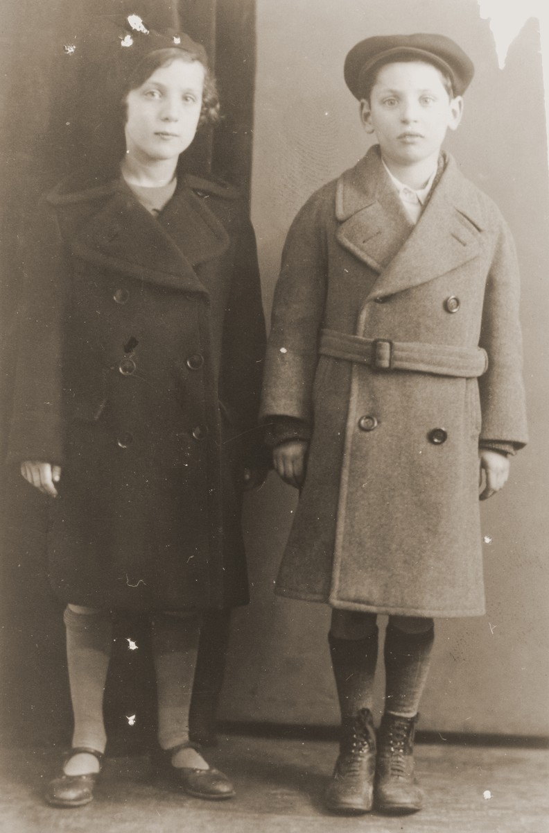Portrait of the twins, Kurt and Ilona Penner dressed in their overcoats.  This photo was taken shortly before their departure for England.