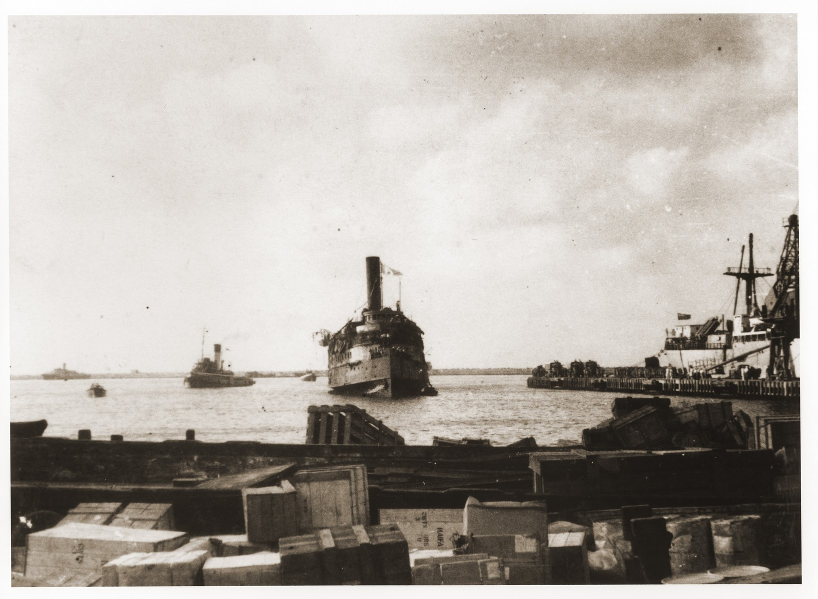 The Exodus 1947 limps into the port of Haifa after being battered by British destroyers during its interception at sea.