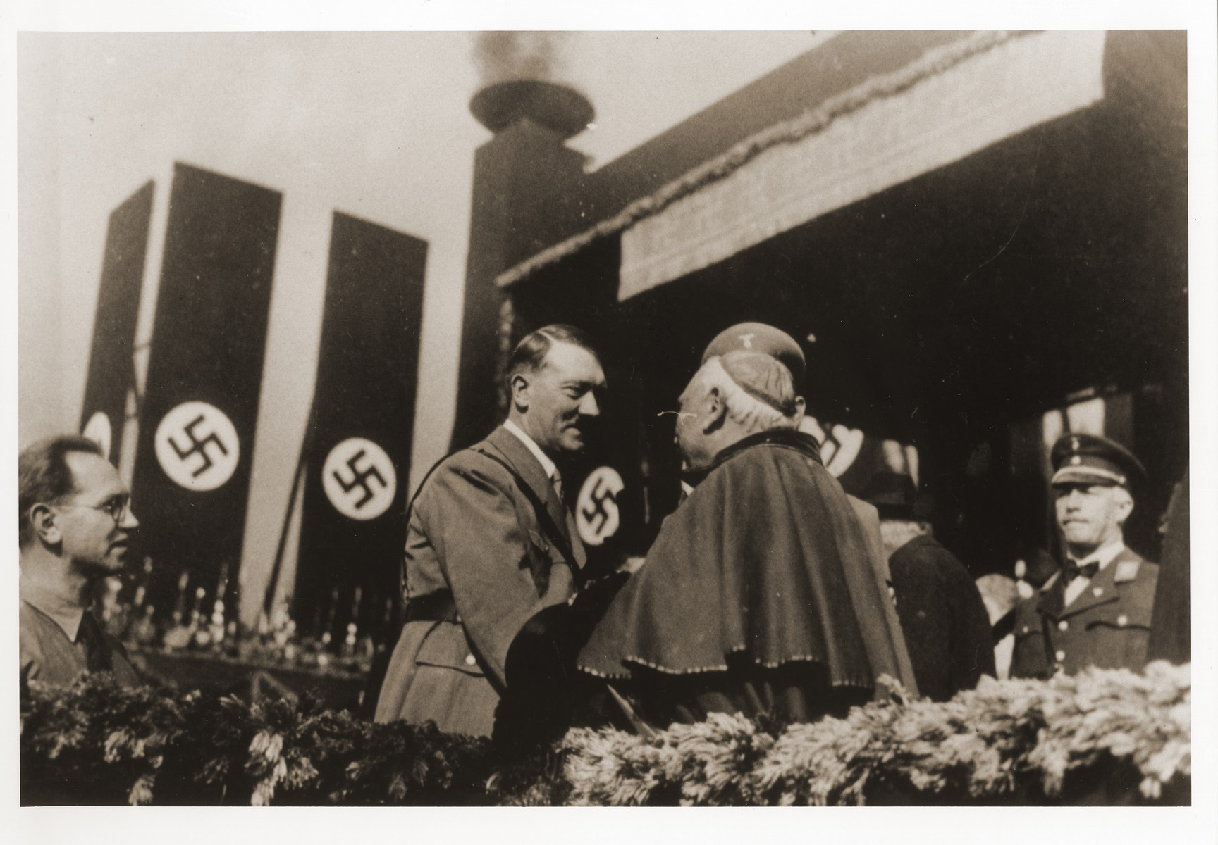 Adolf Hitler greets Munich Nuncio Archbishop Alberto Vassallo di Torregrossa, Munich, 1933. The occasion was probably the ground stone laying ceremony at the Haus der Kunst (Art Exhibition Hall) in Munich, October 15, 1933. The Vatican subsequently protested the Nazi Party's use of the photograph for election propaganda.