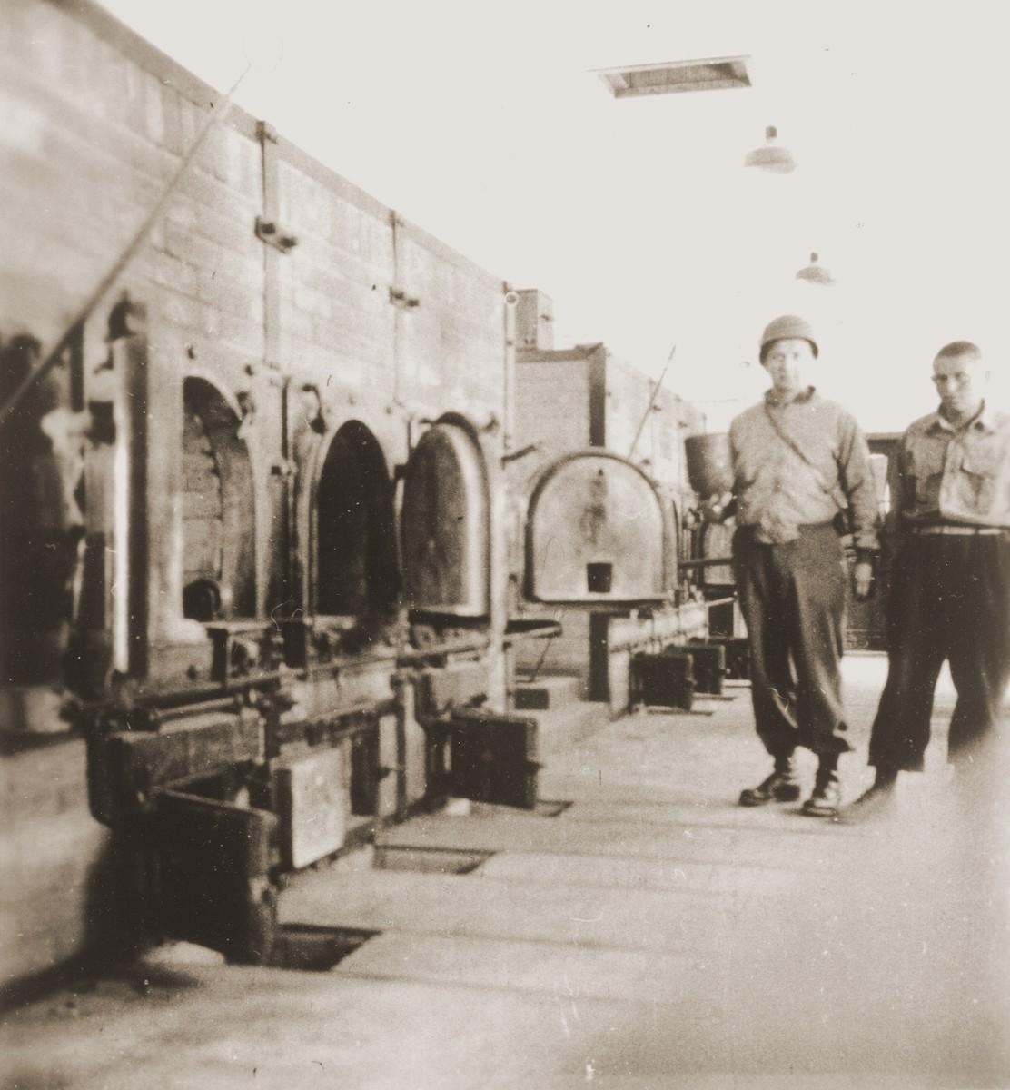 An American soldier inspects the crematorium in Buchenwald.