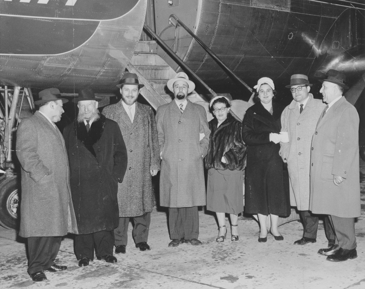 Rabbi Eliezer Silver disembarks from an airplane to visit to the DP camps of Europe.