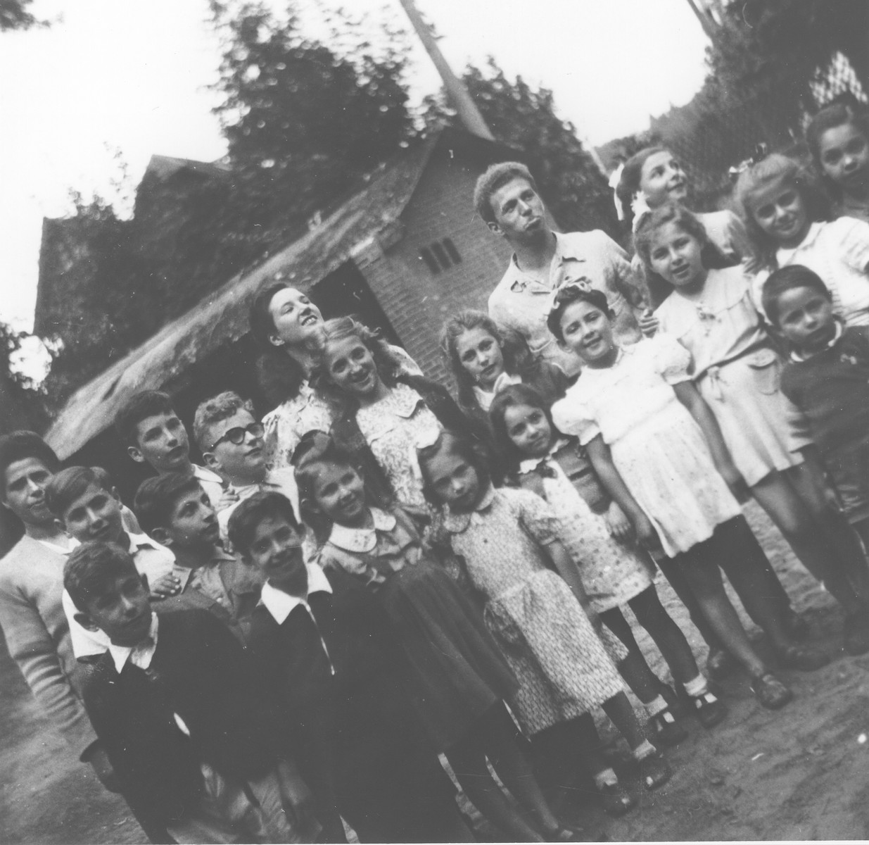 Group portrait of Jewish children at the OSE (Oeuvre de Secours aux Enfants) children's home in Masgelier.   Arnold Bluschtein is pictured standing second from the right in the back row.