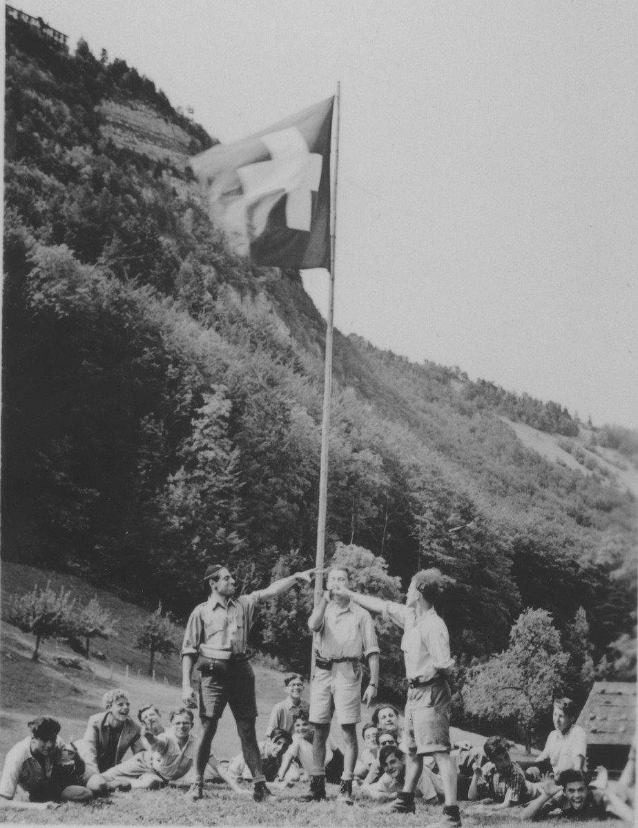 On the Swiss independence day, boys from the Hôme de la Forêt children's home pose next to a Swiss flag at the historic site where the Swiss took an oath to drive out the Austrians.