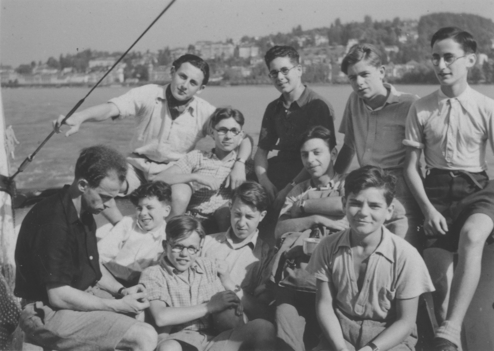 "Boys from the Hôme de la Forêt children's home on a summer boat excursion on Lake Lucerne.  Among those pictured are Simon Blass, Henri Karnowski, Victor Grabsztok, Norbert Bikales and ""Bomba"" Meyer."