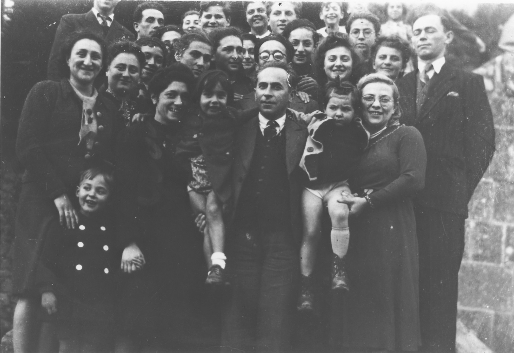 Group portrait of the children and staff of the OSE (Oeuvre de Secours aux Enfants) children's home in Masgelier.  Among those pictured are Hans Hirschberg, Dr. and Gertrude Blumenstock, Kurt Leuchter, Theo Brenig and Isidor and Louba Pudermacher, Boris, Luba and Isidor.
