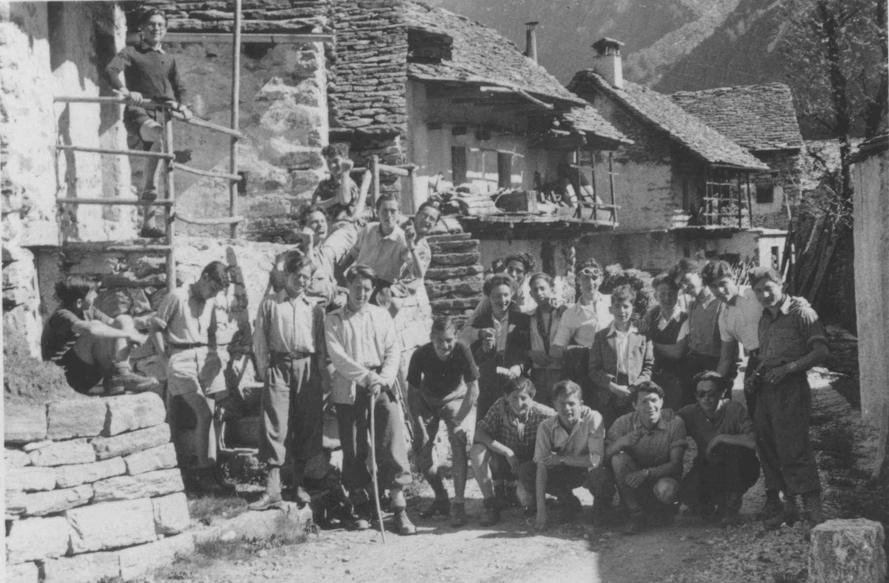 "Boys from the Hôme de la Forêt children's home pose in a rustic village during a summer excursion.  Those pictured include Henri Karnowsky, his brother, Heinz Dewald, and ""Jukoff""."