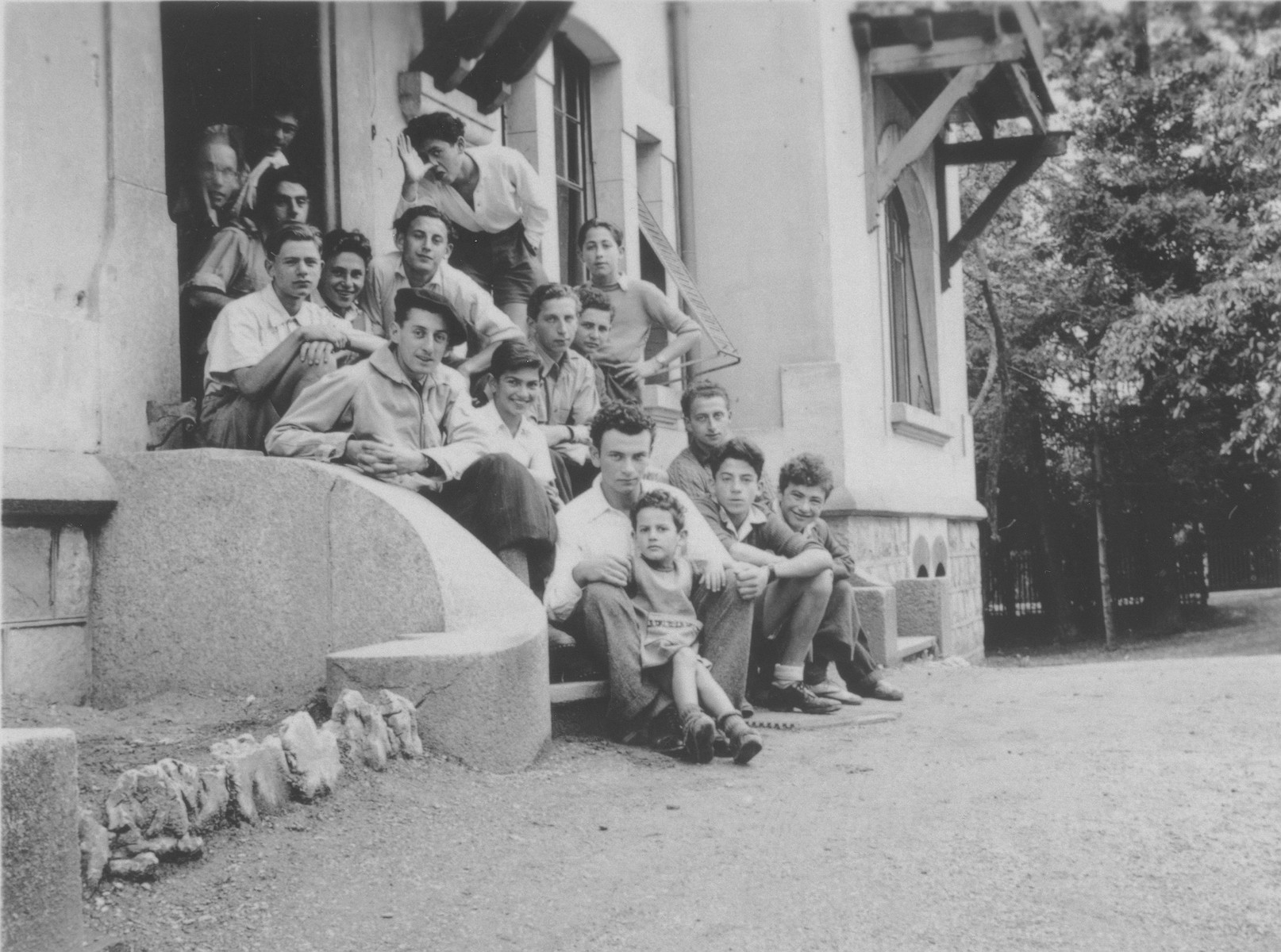 Group portrait of Jewish refugee boys in the Hôme de la Forêt, a children's home run by the OSE (Oeuvre de Secours aux Enfants) in Geneva, Switzerland.  Among those pictured are Gilles Segal and Norbert Bikales. Sitting on front row on the row is Max.
