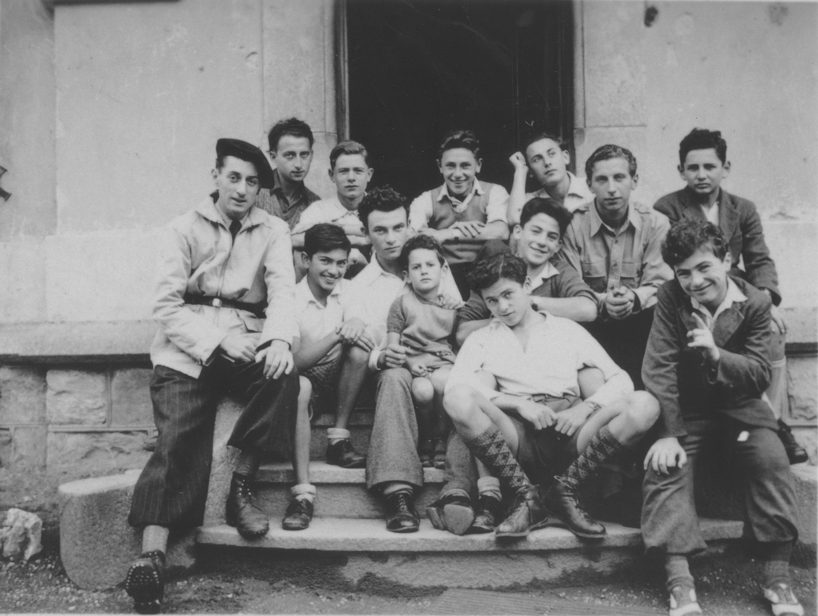 Group portrait of Jewish refugee boys in the Hôme de la Forêt, a children's home run by the OSE (Oeuvre de Secours aux Enfants) in Geneva, Switzerland.  Among those pictured are Gilles Segal and Norbert Bikales.