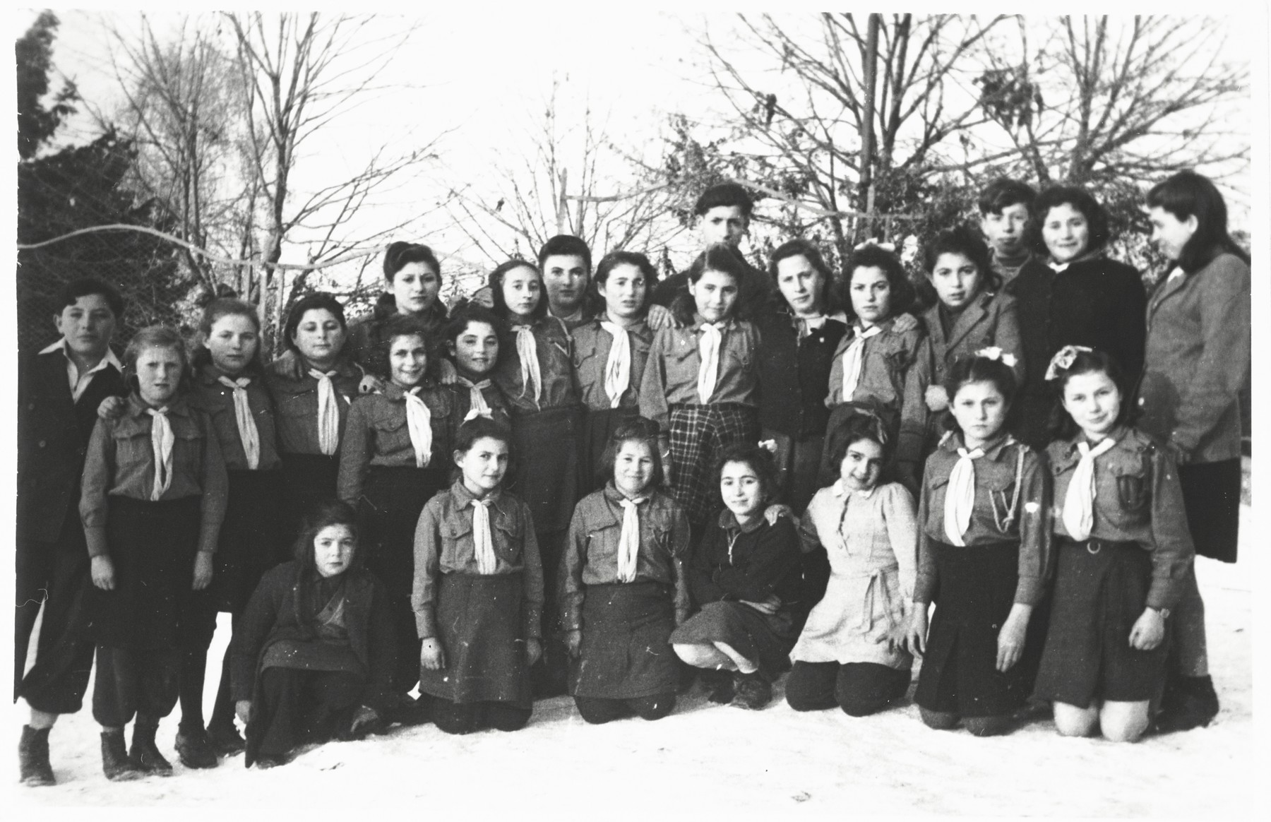 Group portrait of members of the Nitzanim Zionist youth group all in uniform, at the Selvino children's home.