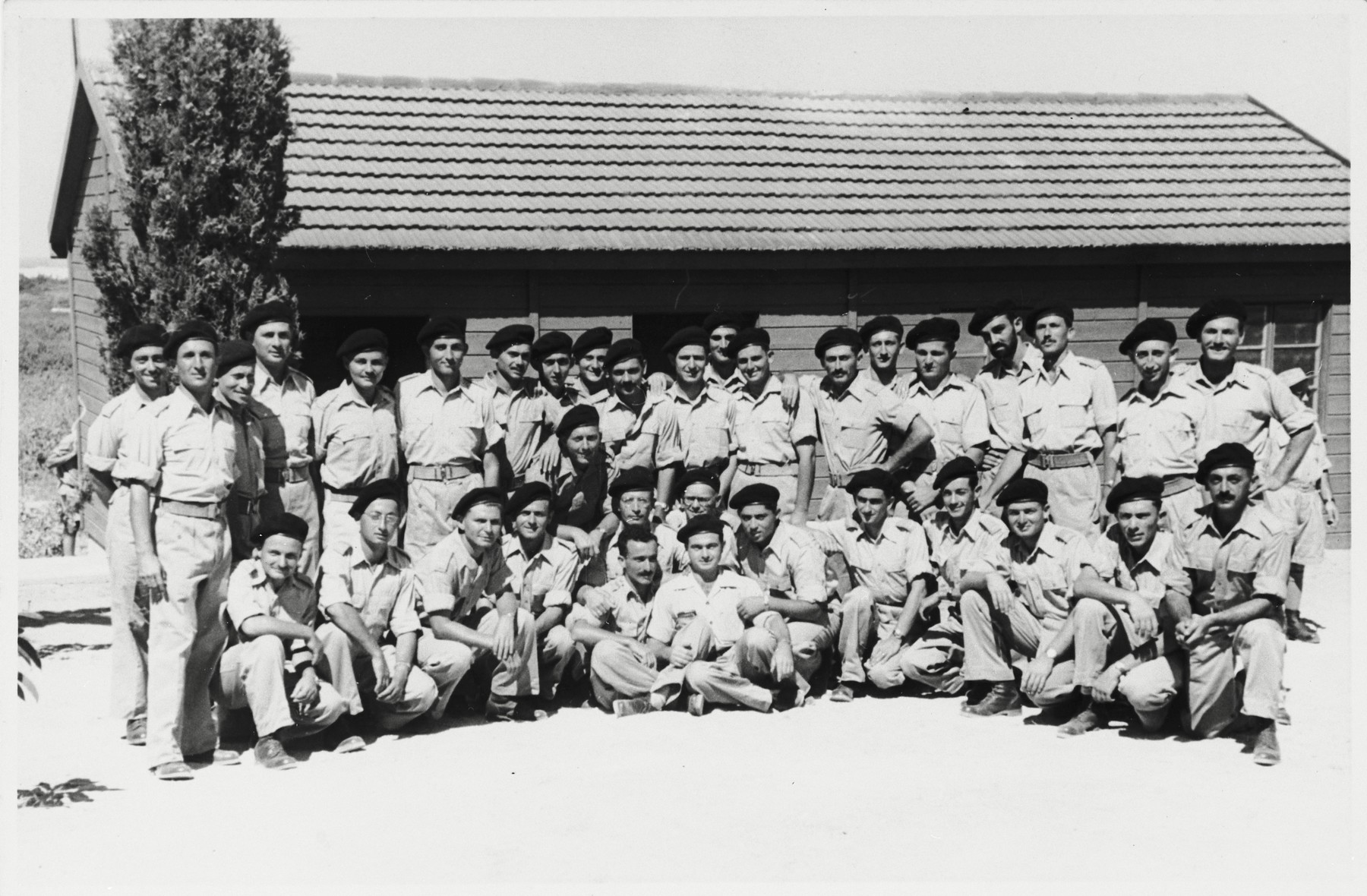 Group portrait of soldiers in a field artillery officers course.  Among those pictured is Shmuel Shalkovsky.
