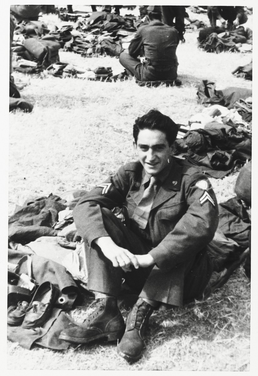 Sam Schalkowsky sits among his belongings at an army base in Korea.