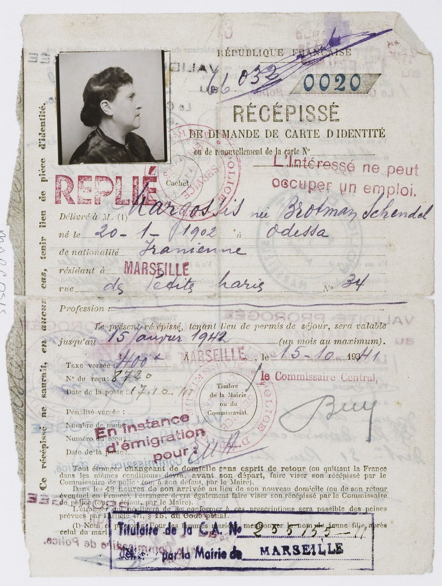 Identification card for Schendel Margosis issued by the Marseilles police stating that she is a Persian citizen and not permitted to work.  The card was stamped by the police at regular intervals.